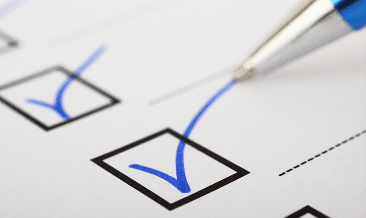Pen making checkmark when researching a board portal feature comparison