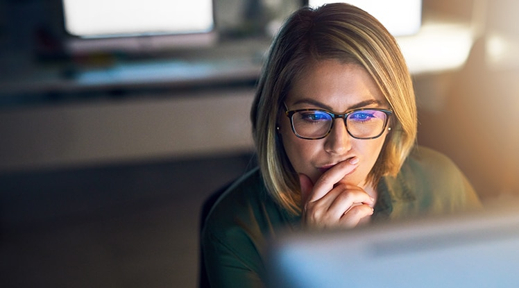 Young businesswoman working late on a computer