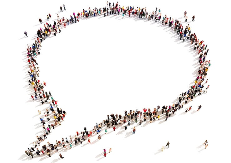 Large group of people in the shape of a chat bubble