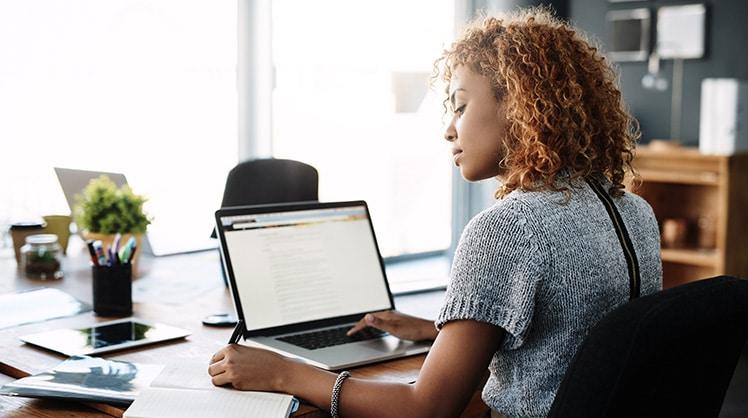 Woman working hard to run a board meeting