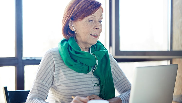 Woman participating in virtual AGM