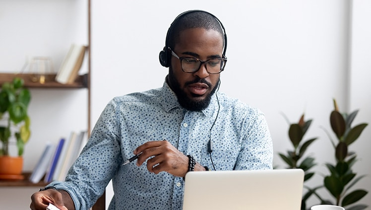 Man in a virtual annual general meeting